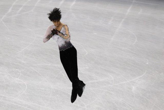 Yuzuru Hanyu a aussi mérité l'or à Sotchi.... (PHOTO TORU HANAI, REUTERS)