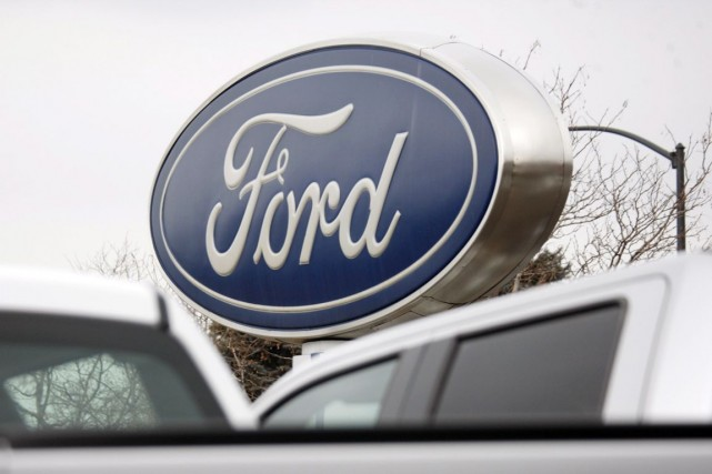 À Wall Street, l'action Ford gagnait 0,22% à... (Photo David Zalubowski, AP)