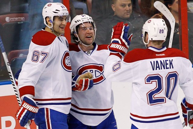 David Desharnais (au centre) a récolté 12 points... (Photo Terry Renna, AP)