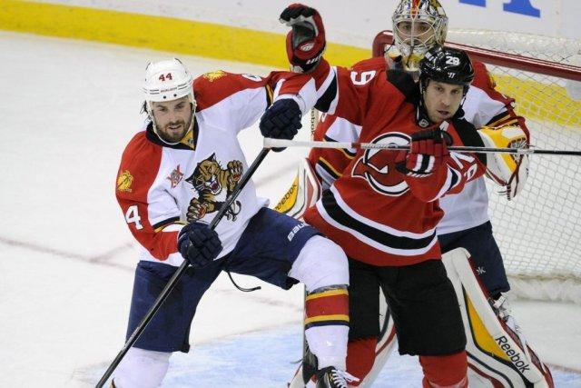 Travis Zajac a réalisé le premier tour du chapeau de sa carrière et les Devils... (Photo: AP)