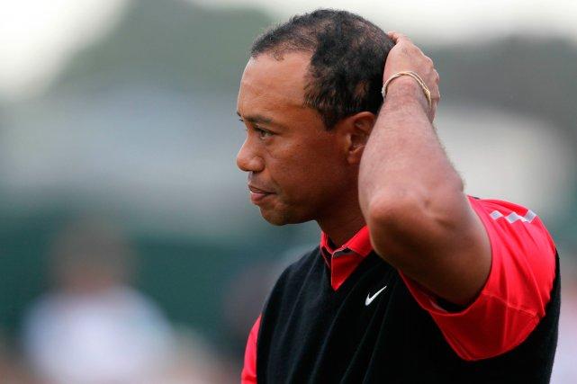 Tiger Woods a été opéré pour soigner un... (Photo Peter Muhly, AFP)