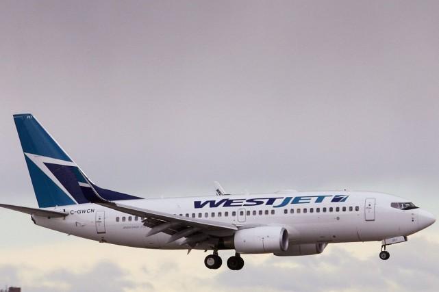 Le bénéfice par action de WestJet est ressorti... (PHOTO ARCHIVES REUTERS)