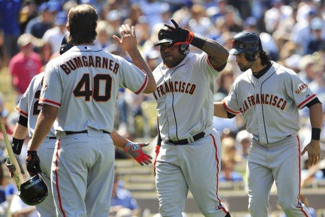 Pablo Sandoval (48) festoie avec ses coéquipiers après... (Photo Gary A. Vasquez, USA Today)