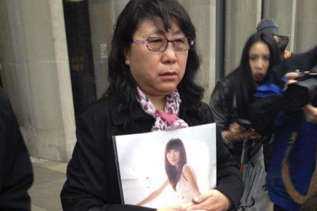 La mère de Qian Liu,Ya Ru Zheng, tient... (Allison Jones)