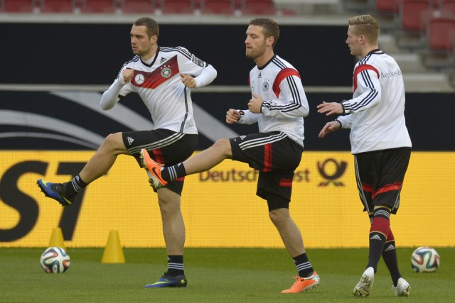 Les joueurs Pierre-Michel Lasogga, Shkodran Mustafi et Andre... (Photo AFP)