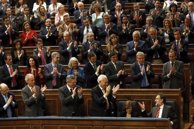 Le chef du Parti populaire, Mariano Rajoy (en... (Photo: Reuters)