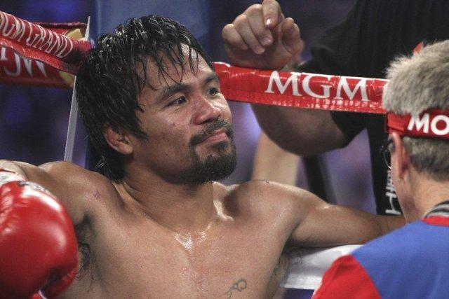 Le prochain combat de Pacquiao devrait l'opposer au... (PHOTO ISAAC BREKKEN, AP)