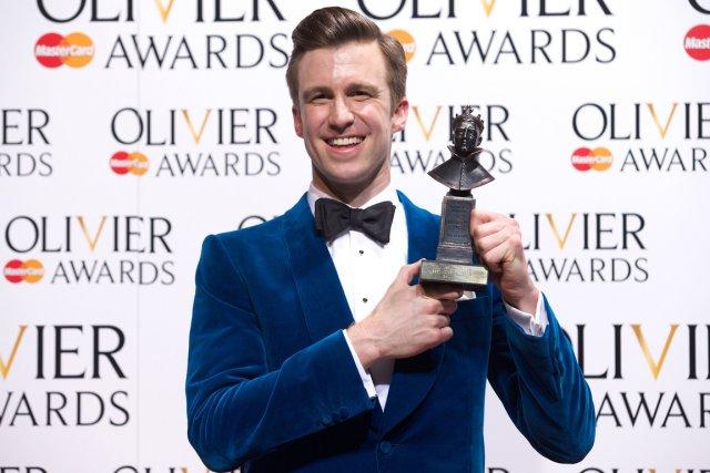 Gavin Creel a remporté le trophéedu meilleur acteur... (PHOTO ANDREW COWIE, AFP)
