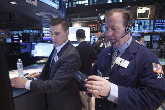 Wall Street a fini dans le vert une séance mouvementée, marquée par une chute... (PHOTO CARLO ALLEGRI, ARCHIVES REUTERS)