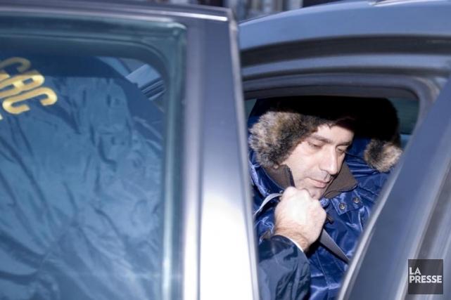 Giuseppe Torre lors de son arrestation à Laval,... (PHOTO ALAIN ROBERGE, ARCHIVES LA PRESSE)