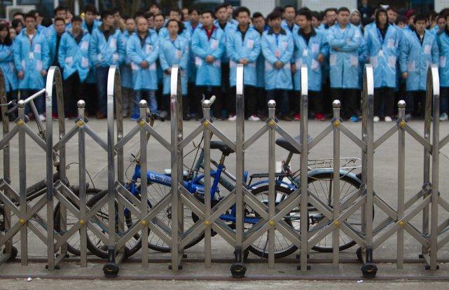 Plus de 30 000 employés de l'usine Yue... (Photo ALEX LEE, Archives Reuters)