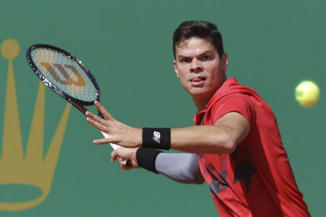 Milos Raonic... (Photo Jean-Christophe Magnenet, Agence France-Presse)