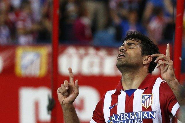 Diego Costa a marqué un but surun penalty.... (PHOTO JUAN MEDINA, REUTERS)