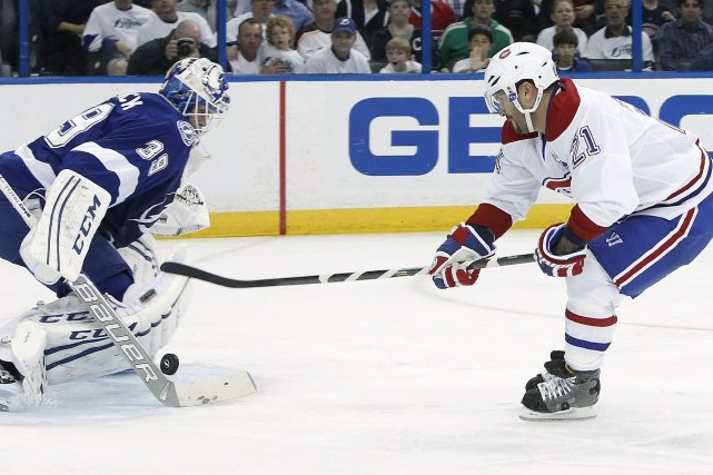 L'attaquant du Canadien Brian Gionta tire vers le... (Photo Kim Klement, USA Today)