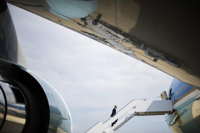 L'avion Air Force One transportant M.Obama a décollé... (PHOTO JIM WATSON, AFP)