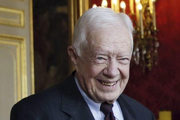 L'ancien président américain Jimmy Carterétait à Paris, mardi,... (Photo PATRICK KOVARIK, AFP)
