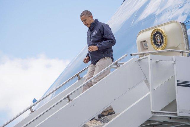 En route vers l'Asie, Barack Obama a fait... (PHOTO JIM WATSON, AFP)