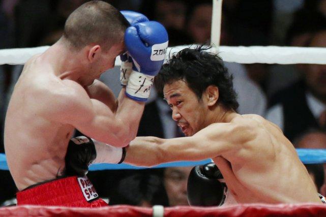 Le Japonais Shinsuke Yamanaka (à droite) a battu... (Photo AFP)