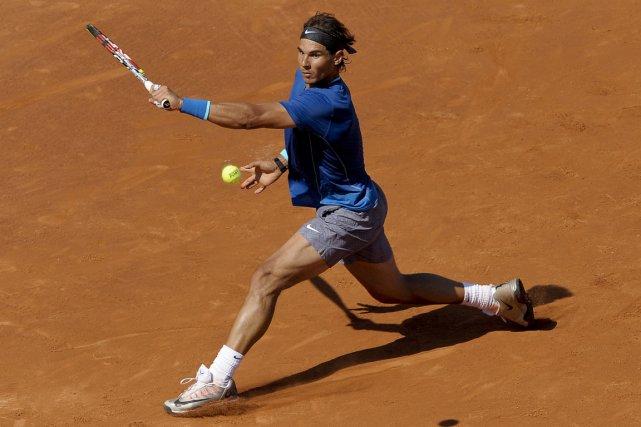 Rafael Nadal a dû travailler fort pour vaincre... (Photo Josep Lago, AFP)