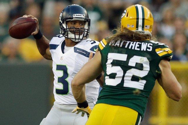 Russell Wilson, des Seahawks de Seattle, et Clay... (Photo Morry Gash, archives AP)