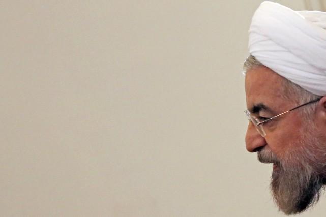 Le dirigeant iranien Hassan Rohania critiqué sans les... (PHOTO MASSOUD HOSSAINI, ARCHIVES AP)
