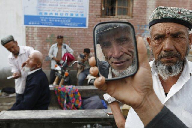 Les Ouïghours affirment être exclus des efforts d'investissements... (PHOTO WILLIAM HONG, REUTERS)