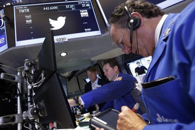 Les indices new-yorkais ouvraient sous pression après la... (Photo La Presse Canadienne)