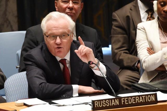 «Nous demandons à Kiev et à ses soutiens... (PHOTO STAN HONDA, AFP)
