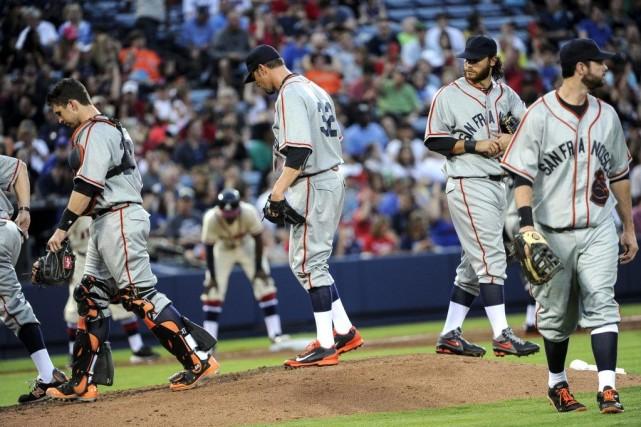 Les Giants ont frappé au moins une longue... (Photo John Amis, AP)