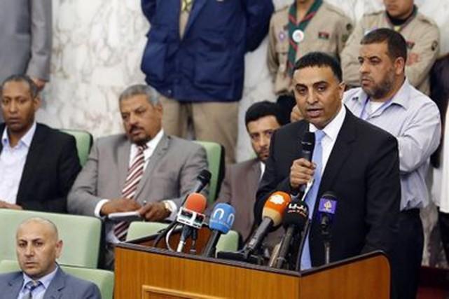 Âgé de 42 ans, Ahmed Miitig est le... (Photo AFP)