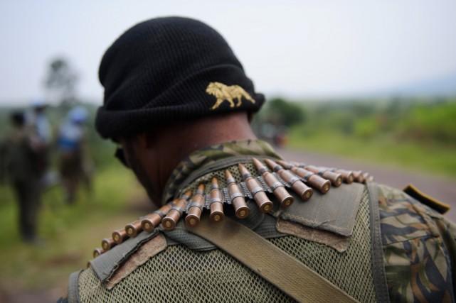Au total, 39 membres de l'armée congolaise étaient... (PHOTO PHIL MOORE, ARCHIVES AFP)