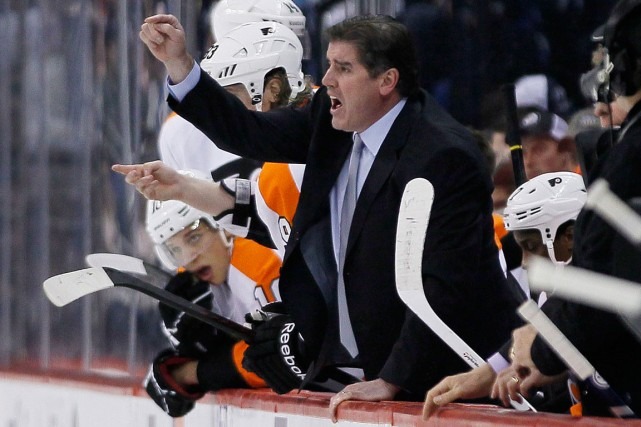 Peter Laviolette a guidé les Hurricanes de la... (Photo John Woods, archives PC)