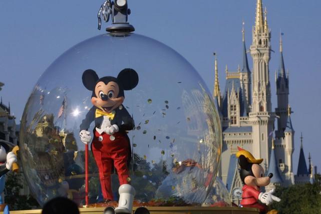 L'action du groupe de médias et de loisirs américain Disney chutait jeudi en... (Photo Archives Getty Images)