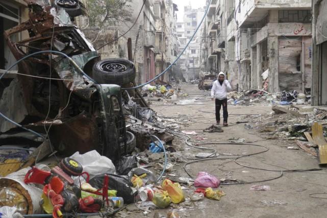 Les rebelles peuvent se targuer de quitter Homs... (PHOTO THAER AL KHALIDIYA, ARCHIVES REUTERS)