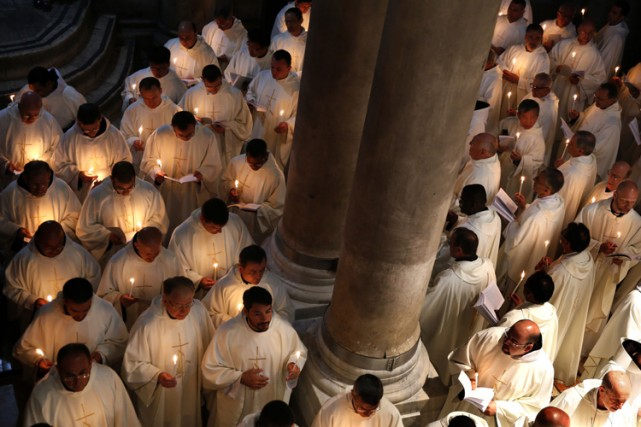 Une messe célébrée dans une église catholique à... (Archives AFP)