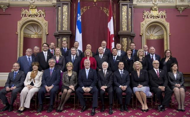 Le conseil des ministres du gouvernement Couillard arrive... (Photo Jacques Boissinot, La Presse Canadienne)