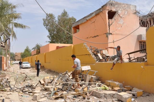 Des heurts opposent ponctuellement forces irakiennes et insurgés... (Photo archives AFP)