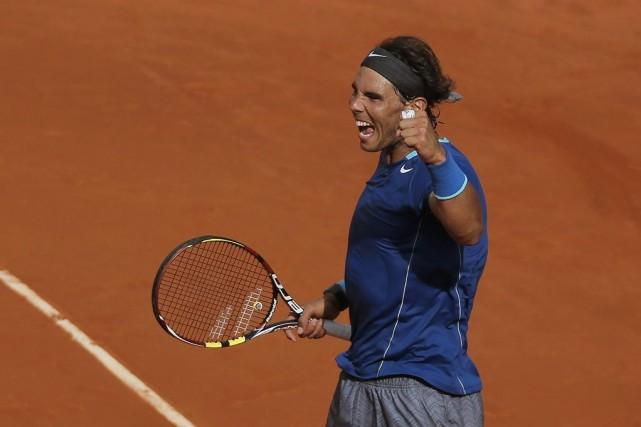 RafaelNadal a remporté son troisième titre de l'année.... (PHOTO ANDRES KUDACKI, AP)