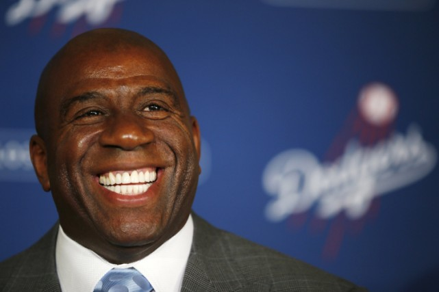 Magic Johnson est directement concerné par l'affaire Sterling,... (Archives Reuters)