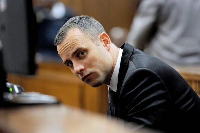 Oscar Pistorius, au tribunal de Pretoria, le 12... (PHOTO CHRIS COLLINGRIDGE, AFP)