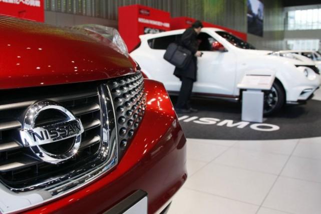 Nissan a prévu lundi une légère hausse de son bénéfice net en 2014-2015 grâce à... (Photo d'archives)
