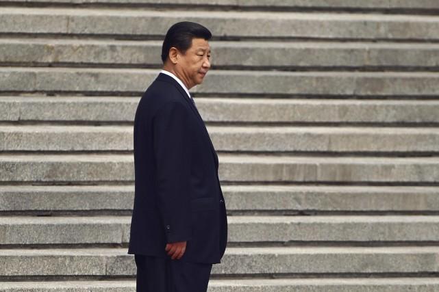 Le président chinois Xi Jinping... (Photo PETAR KUJUNDZIC, Reuters)