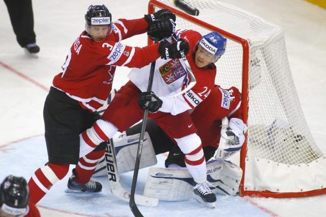 Le Canada a marqué deux fois au cours d'une pénalité majeure imposée à Jan... (Photo AP)