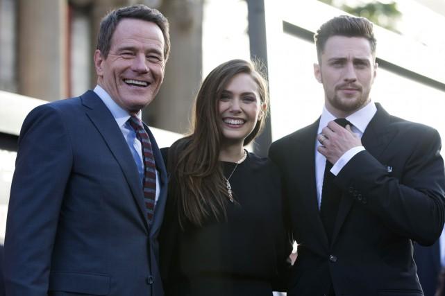 Bryan Cranston (gauche), Elizabeth Olsen et Aaron Taylor-Johnson... (Photo: Reuters)