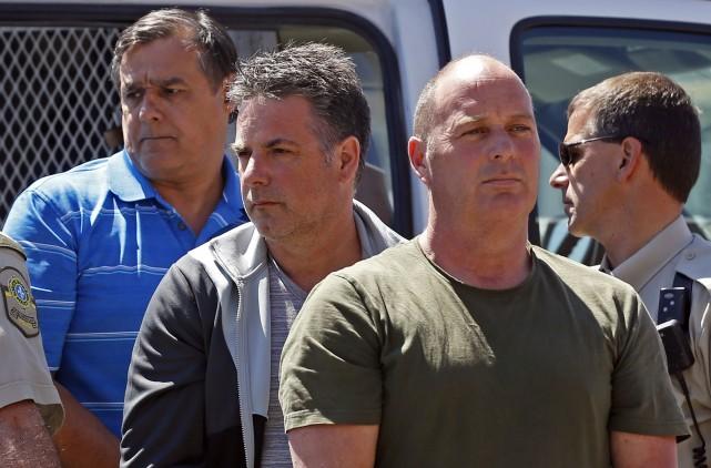 Les trois accusés: Thomas Harding (à droite), Jean... (Photo Mathieu Bélanger, Reuters)