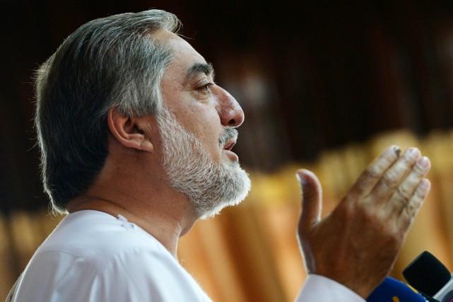 Avec 45% des voix au premier tour du... (PHOTO WAKIL KOHSAR, AFP)