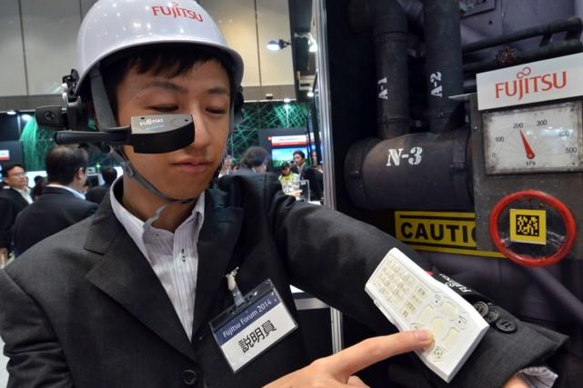 Fujitsu a organisé son mini-salon annuel jeudi et... (Photo Yoshikazu TSUNO, AFP)