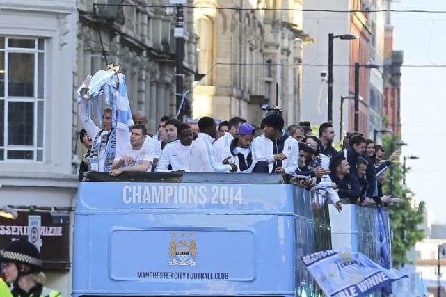 Les joueurs deManchester City ont participé à la... (PHOTO LINDSEY PARNABY, AFP)
