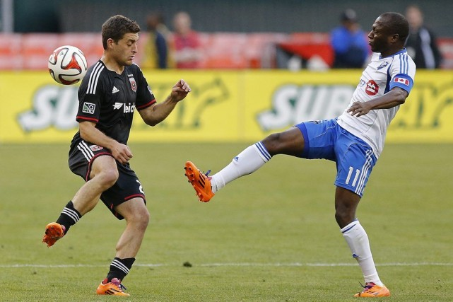 Perry Kitchen et le milieu de l'Impact Sanna... (Photo USA TODAY Sports)