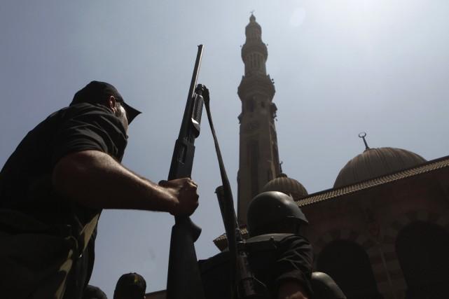 Des hommes armés circulant à bord d'une voiture ont ouvert le feu tôt mardi sur... (Photo AMR ABDALLAH DALSH, Archives Reuters)